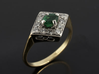 Oval Cut Emerald with Diamond Cluster White and Yellow Gold
