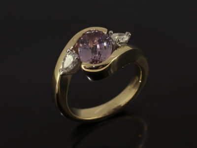 Oval Cut Peach Sapphire 2.27ct with Side Pear Cut Diamonds 0.31ct Total F Colour VS Clarity Minimum in and 18kt Yellow Gold and Platinum Twist Design