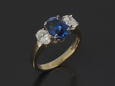Oval Sapphire 2.08ct, Oval Cut Diamonds 0.66ct x 2 18kt Yellow Gold Platinum Trilogy