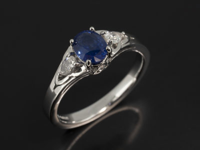 Oval Sapphire 1.82ct with Side Pear Cut Diamonds 0.32ct in a Platinum Trilogy Celtic Split Band Design