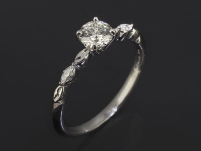 Round Brilliant Cut Diamond Trilogy with Marquise Cut Diamond Shoulders