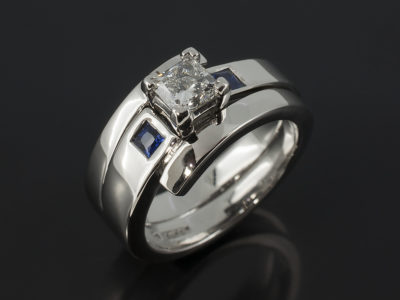 Palladium Claw Set Princess Cut Diamond And Secret Set Square Cut Sapphire Design Engagement Ring With Fitted Wedding Ring