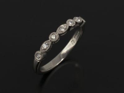 Palladium Pavè Set Round Brilliant Cut Diamond Ring with Filigree Leaf Detail