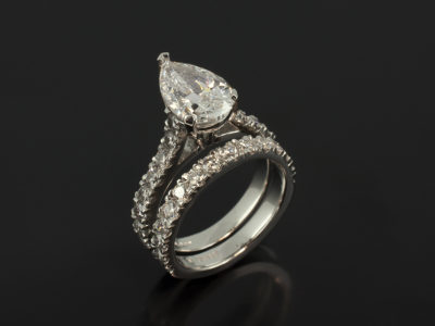 Pear Shape 2.34ct D SI1 and Round Brilliant Cut Diamonds 0.68ct Total in a Platinum Claw and Castle Set Design with Fitted Diamond Castle Set Platinum Wedding Ring 0.61ct Total