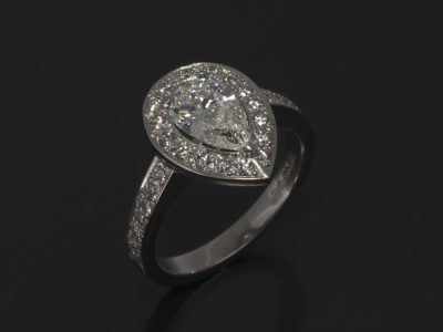 Pear shape diamond 1.03ct with Round Brilliant Cut Diamond platinum halo and shoulder 0.45ct (30)