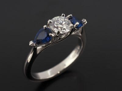 Platinum 0.60ct Round Brilliant Cut Diamond with Pear Cut Sapphires 0.69ct (2)
