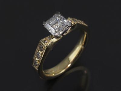 Platinum & 18kt Yellow Gold Claw & Pavé Set Design. Asscher Cut Diamond, 0.91ct, D Colour, SI1 Clarity. Round Brilliant Cut Diamonds EXEX Approximately 0.20ct (10)