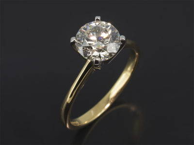 Platinum & 18kt Yellow Gold Claw Set Solitaire Design. Round Brilliant Cut Diamond, 1.51ct. K Colour, SI2 Clarity, No Fluorescence. Excellent Cut, Excellent Polish, Excellent Symmetry.