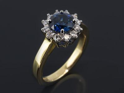 Platinum & 18kt Yellow Gold Cluster Design. Round Brilliant Cut Sapphire 1.35ct. Round Brilliant Cut Diamonds, 0.35ct (12)