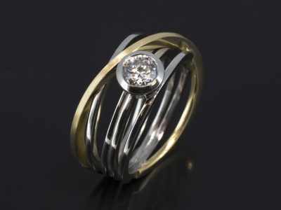 Platinum & 18kt Yellow Gold Rub-over set Design. Round Brilliant Cut Diamond, 0.74ct, D Colour, SI1 Clarity