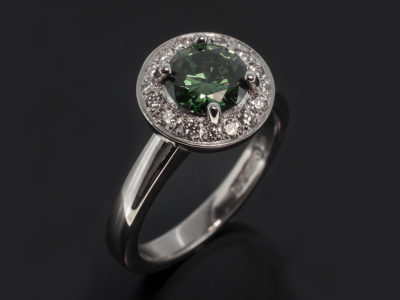 Platinum 4 Claw Halo Design. Round Brilliant Green Diamond 0.94ct. Round Brilliant Cut Diamond, 0.20ct (16), F Colour, VS Clarity Minimum.