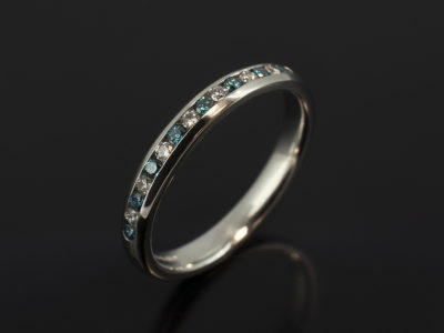 Platinum Channel Set Eternity Ring with Round Brilliant Cut Blue and White Diamonds 0.25ct Total