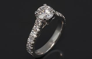Platinum Claw & Castle Set Design. Round Brilliant Cut Diamond, 1.20ct, E Colour, SI1 Clarity. Round Brilliant Cut Diamonds, 0.80ct (12). FVS-CROPPED
