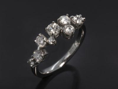 Platinum Claw Set Design Round Brilliant Cut Diamond, 0.16ct. Round Brilliant Cut Diamonds, 0.49ct (5). Round Brilliant Cut Diamonds, 0.08ct (3).