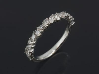 Platinum Claw Set Design. Marquise Cut Diamond 0.20ct (8) and Round Brilliant Cut Diamond 0.10ct (7)