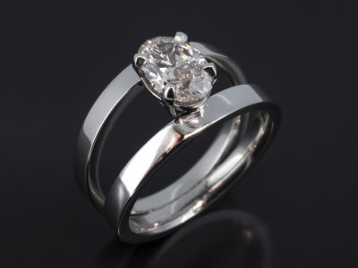Platinum Claw Set Design. Oval 1.08ct, H - I Colour, VS Clarity