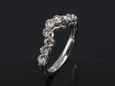 Platinum Claw Set Fitted Design. Round Brilliant Cut Diamonds, 0.90ct. F Colour, VS Clarity Minimum