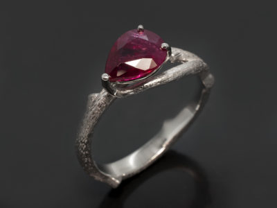 Platinum Claw Set Organic Off-Set Design. Pear Shape Ruby, 1.29ct