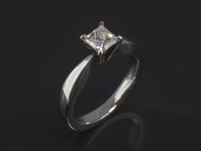 Platinum Claw Set Solitaire Design. Princess Cut Diamond, 0.60ct, G Colour, VS2 Clarity. Very Good Polish, Very Good Symmetry