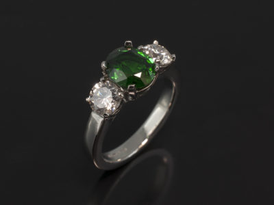 Platinum Claw Set Trilogy Design with Oval Cut Tsavorite 1.14ct and Round Brilliant Cut Diamonds 0.41ct (2) H Colour, VS2 and SI