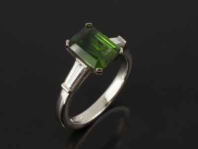 Platinum Claw Set Trilogy with Emerald Cut Green Tourmaline 2.07ct and Tapered Baguette Cut Diamonds 0.50ct Total