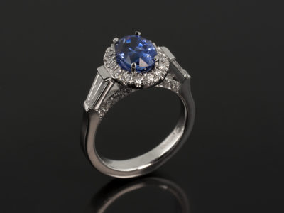 Platinum Claw and Castle Set with Oval Sapphire 1.55ct, Tapered Baguettes 0.39ct and Round Brilliant Cut Diamonds 0.26ct