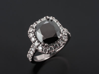 Platinum Cushion Cut Black Diamond 3.35ct With Round Brilliant Cut Diamond Halo and Shoulder in a Castle Set Design