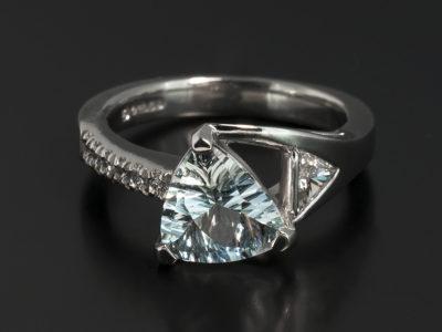 Platinum Dress Ring. Trilliant Cut Aquamarine, 1.16ct. Triangle Diamond, 0.15ct, F Colour, SI Clarity Minimum. Round Brilliant Cut Diamond, 0.09ct (6), F Colour, SI Clarity Minimum