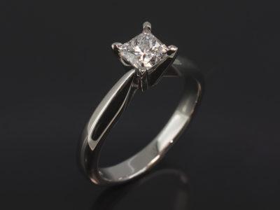Platinum Four Claw 'V' Set Design. Princess Cut Diamond, 0.60ct, D Colour, SI2 Clarity. Very Good Polish, Excellent Symmetry, No Fluorescence