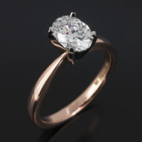 Platinum Four Claw Set & 18kt Red Gold Solitaire Design. Oval Cut Diamond, 1.04ct, D Colour, SI1 Clarity. Excellent Polish, Excellent Symmetry, Nil Fluorescence.
