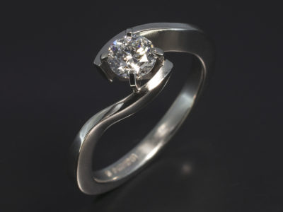 Platinum Four Claw Set Twist Design. Round Brilliant Cut Diamond, 0.53ct, D Colour, SI2 Clarity.EXEXEX