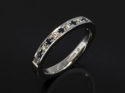 Platinum Pavè Round Brilliant Cut Diamond, 0.10ct (7), F Colour, SI Clarity Minimum. Round Brilliant Cut Sapphire, 0.12ct