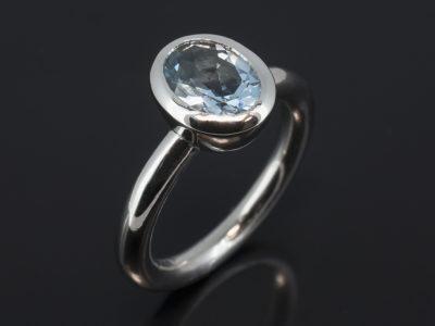 Platinum Rub Over Set Design. Oval Aquamarine, 1.73ct.
