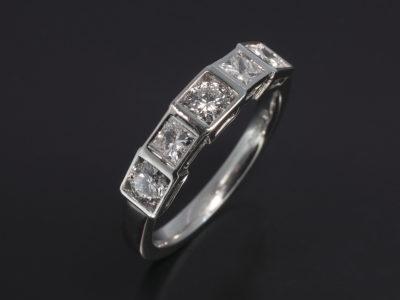 Platinum Rubover Set Design. RBC Diamond, 0.54ct (3), PC Diamonds, 0.28ct (2)