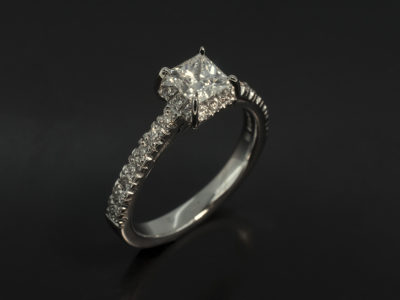 Princess Cut Diamond 0.60ct E Colour SI1 Clarity EXEX in an 18kt White Gold Halo Diamond Set Design with Diamond Set Shoulders and Scroll Detail on Band