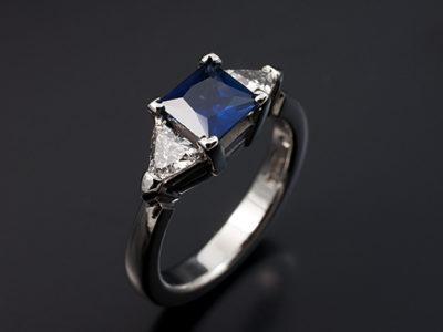 Princess Cut Sapphire and Trilliant Cut Side Diamonds