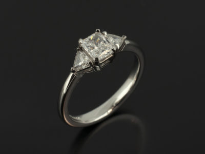 Radiant Cut 0.50ct D Colour VS2 Clarity with Trilliant Cut Side Diamonds 0.20ct Total in a Platinum Claw Set Trilogy Design