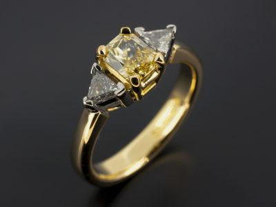 Emerald Cut Radiant Yellow Sapphire with Trilliant Cut Side Diamonds