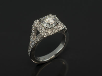 Round 1.26ct F SI in a claw and Channel set Halo and split shoulder Platinum Design