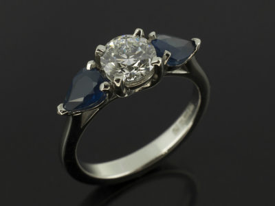 Round Brilliant Cut Diamond 0.62ct D Colour SI1 EXEXEX with 0.90ct Total Sapphire Pear Cut in Claw Set Palladium Design