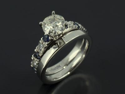 Round Brilliant Cut 0.78ct with Round Brilliant Cut Diamonds and Sapphire Shoulders in Platinum
