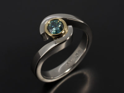 Round Brilliant Cut Blue Diamond 0.33ct in a 18kt Yellow Gold and Palladium Twist Rub Over