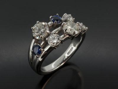 Round Diamond and Sapphire Satellite Platinum ring