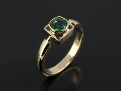 Round Emerald 6mm with Round Sapphires 4 x 1.5mm in a 18kt Yellow Gold Rub Over Contemporary Design