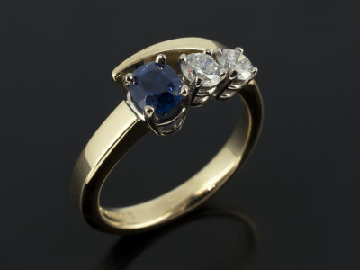 Sapphire 0.95ct with Round Brilliant Cut Diamonds 0.53 total 18kt Yellow Gold White Gold Twist