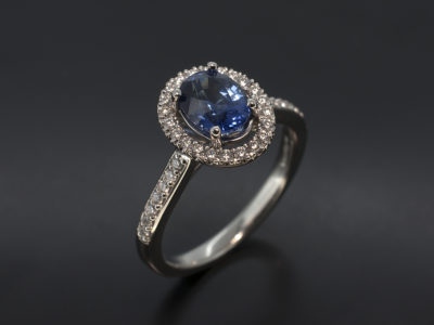 Oval Cut Sapphire with Diamond Halo & Shoulder