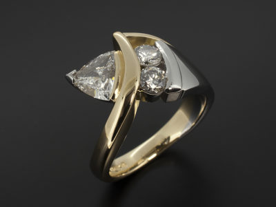 Trilliant cut 0.78ct E colour diamond, VS2 VGVG with Roundcut diamond 0.2ct x 2 in a Platinum and 18kt Yellow Gold Twist