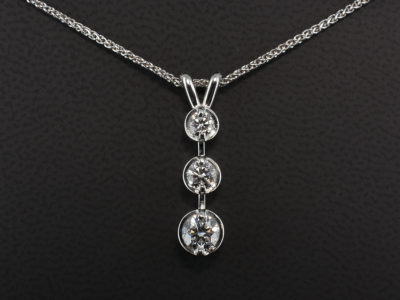 18kt White Gold Claw Set Pendant. Round Brilliant Cut 0.32ct E SI2 Excellent Cut Excellent Polish Excellent Symmetry and 0.15ct and 0.10ct F SI Quality with Spiga Chain