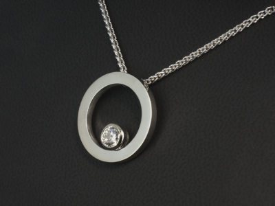 18kt White Gold Rub-over Set Circle Design Pendant, Round Brilliant Cut Diamond, 0.71ct, E Colour, SI1 Clarity, Excellent Cut, Excellent Polish, Excellent Symmetry. 18kt White Gold 20-18 Inch Spiga Chain.