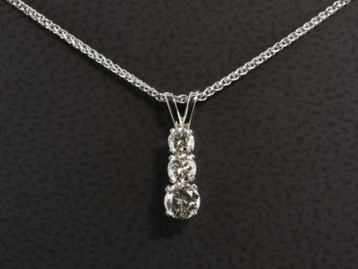 9kt White Gold Claw Set Pendant Design. Round Brilliant Cut Diamond, 0.24ct, 0.15ct, 0.10ct.